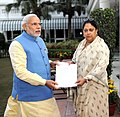 Rajasthan CM Vasundhara Raje presents a draft worth Rs 5 crore to PM Modi.jpg