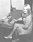 Renee Rockett with typewriter.jpg