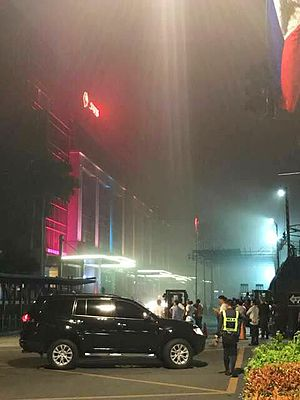 2017 Resorts World Manila attack - Resorts World Manila immediately following the shooting. The complex was shrouded in smoke from fires started by the suspect. Also picture is Maxims Tower, where the attacker committed suicide.