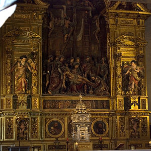 Pedro Roldán - Altarpiece of the Church of the Sanctuary (Iglesia del Sagrario) in Seville; Roldán executed the sculpture of the Descent from the Cross and the relief on the pedestal.