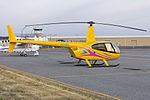 Robinson R44 (VH-UBU) at Wagga Wagga Airport.jpg