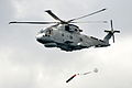 Royal Navy Merlin Helicopter Launching a Training Torpedo MOD 45157953.jpg