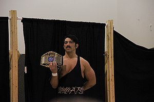 Harley Race's Wrestling Academy - Ryan Drago in 2013 with the WLW Tag Team belt.