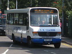 S.M. Coaches R187DNM on route 20 at Epping Station.jpg