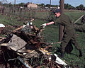 SGT Dan Turner with the Canadian Air force helps to clear debris following an F-5 tornado that devastated a good portion of Oklahoma City, Oklahoma, but just barely missed destroying Tinker AFB, Oklahoma DF-SD-00-03252.jpg
