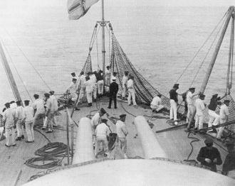 Torpedo net - Stowing torpedo nets on SMS Weissenburg in 1896.