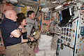 STS-133 ISS-26 Scott Kelly, Cady Coleman and Michael Barratt watch a monitor in the Unity node.jpg