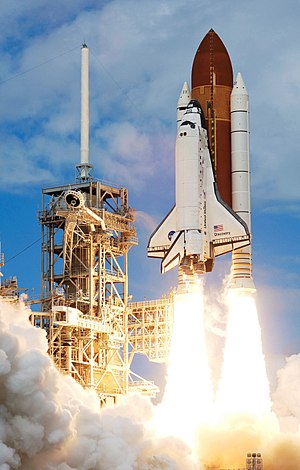 The Space Shuttle Discovery and its seven-memb...
