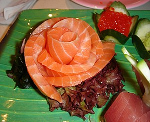 A salmon rose, part of a sashimi dinner set. T...