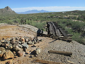 San Xavier, Arizona - Mine dump and ruins of rail haulage at San Xavier. Helmet Peak is at the left and the Santa Rita Mountains are in the background.