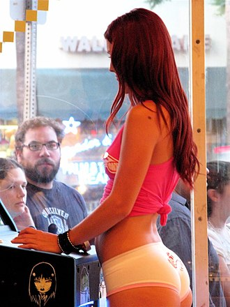 Staring - A man and a woman staring at a scantily-clad woman.