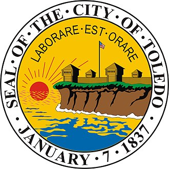 Pray and work - The Toledo city seal has been used since 1873 and shows the sun rising at Fort Industry with the phrase, LABORARE – EST – ORARE