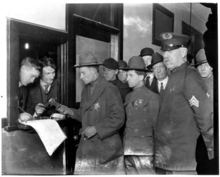 The mayor's newly hired deputies receive their weapons. Seattle General Strike 1919 Deputies receiving weapons.png
