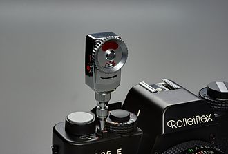 Self timer - A manual self-timer mounted on a film camera