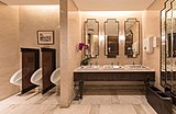 Sinks and urinals in the restrooms of The Fullerton Bay Hotel of Singapore.jpg