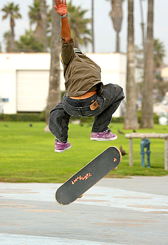 Skateboard - Skateboarder doing a hard-flip