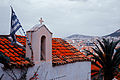 Sky blue-white (Flag of Greece) on a church rooftop against background of Athens cityscape. Athens, Greece.jpg