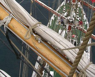 Gasket (sailing) - A gasket holding the main-royal on a modern square-rigged training ship.