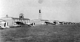 Souther Field - Souther Field - Curtiss JN-4s on the line in front of a row of hangars, 1918