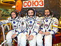 Soyuz TMA-01M Crew in front of the capsule (closeup).jpg