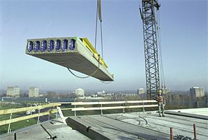 Prestressed concrete - Pre-tensioned hollow-core plank being placed