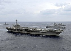 Starboard bow view of USS George Washington (CVN-73) in formation with Japanese and American ships during ANNUALEX 2008 081119-N-8842M-182.jpg