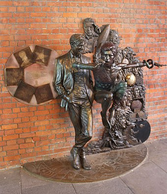 Statue of Bowie in different guises in Aylesbury, Buckinghamshire, the town where he debuted Ziggy Stardust in 1972 Statue of David Bowie (geograph 5942789).jpg