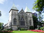 Stavanger Cathedral (Lutheran), Norway, surrounded by a garden.