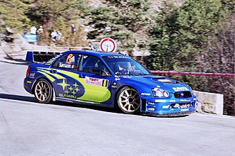 Stéphane Sarrazin - Sarrazin driving a Subaru Impreza WRC on the 2005 Monte Carlo Rally.