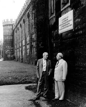Stagg Field - Met Lab scientists Leó Szilárd (right) and Norman Hilberry under a plaque commemorating CP-1 on the West Stands of Old Stagg Field