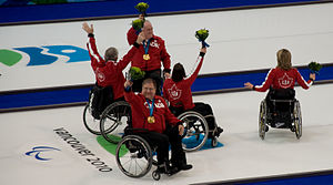 Bruno Yizek - Bruno Yizek (center front) with the Canadian team winning gold at Vancouver 2010