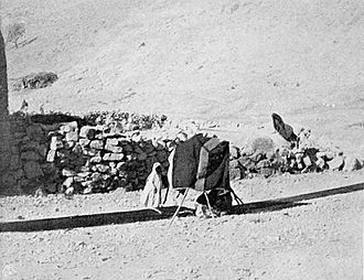 Bedouin - Weaving lengths of fabric for tent making using ground loom. Palestine, circa 1900