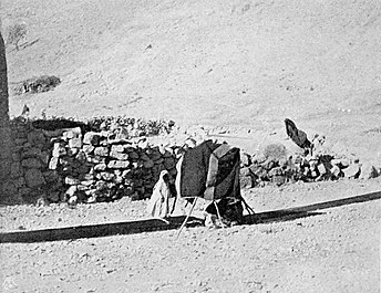Weaving lengths of fabric for tent making using ground loom. Palestine, c. 1900 Tent making.jpg