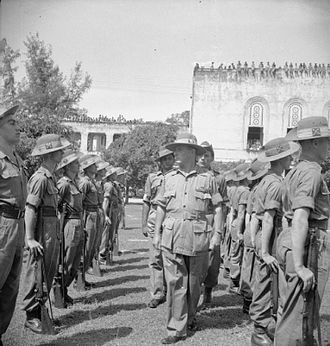 Royal Berkshire Regiment - Lieutenant General Sir Montagu Stopford, General Officer Commanding-in-Chief (GOC-in-C) of the British 12th Army, inspects a guard of honour mounted by men of the 1st Battalion, The Royal Berkshire Regiment, during the formal ceremony in Rangoon where General Heitarō Kimura and his staff handed over their swords to staff officers of the 12th Army.