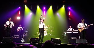 Tony Hicks - The Hollies in 2013  (L-R: Steve Lauri, Ray Stiles, Peter Howarth, Bobby Elliott, Ian Parker, Tony Hicks)