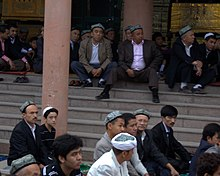 The Islamic Faithful along the Id Kah Mosque on Eid Ul-Fitr (5016459553).jpg