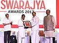 The Vice President, Shri M. Venkaiah Naidu presenting Ustad Bismillah Khan Award for Culture to Shri Sirivennela Sitarama Sastry, at an event to present Swarajya Awards 2017, in Panaji, Goa.jpg
