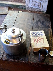 The World Almanac and Book of Facts, 1987, beside a Tea Kettle, Instrument workshop, TIPA, Dharamsala.jpg
