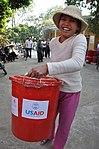 Thian Thi Ngoi from Lien Chau District carries home flood assistance supplies funded by USAID. (5702521855).jpg