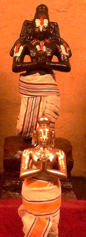 Thiruppaan Alvar - Image of the granite and festival image of Thirupaan in Alwarthirunagari Temple
