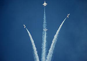United States Air Force Thunderbirds - The Thunderbirds performing their signature bomb burst maneuver.