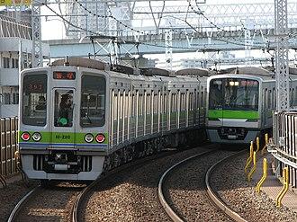 Toei Shinjuku Line - Toei 10-000 series (left) and 10-300 series EMUs at Funabori Station