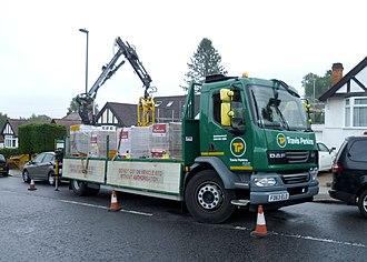 Travis Perkins - A Travis Perkins lorry unloading in London.