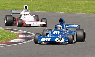 Tyrrell 006 - Tyrrell 006, driven by John Delane, leads a Trojan T103 at the 2007 Silverstone Classic meeting, July 2007