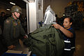 U.S. Air Force Airman 1st Class Ondina Flores, a base information transfer center custodian with 20th Communications Squadron, inspects a mobility bag containing proper chemical warfare gear before issuing it to 070806-F-RX342-018.jpg