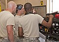 U.S. Air Force Senior Airmen Alfred Fyvie, Joshua Ruberg and Mister Braxton, all with the 361st Training Squadron, check the wiring diagram panel to troubleshoot an electrical problem June 8, 2011, at Sheppard 110608-F-NS900-031.jpg