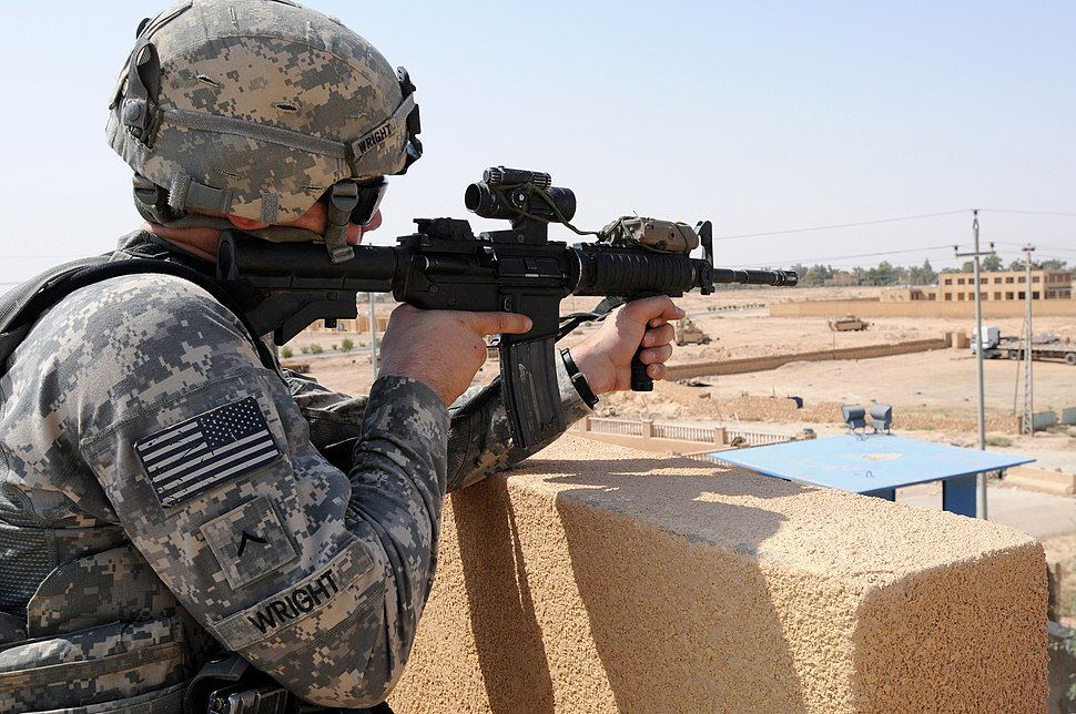 U.S. Army Pvt. Aaron Wright pulls security on the roof of an Iraqi police station in Haqlaniyah, Anbar province, Iraq, July 13, 2011 110713-A-FO214-762
