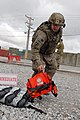 U.S. Army Spc. Joshua Adams, a medic with Headquarters and Headquarters Company, 555th Engineer Brigade, picks up medical supplies during a company mass casualty training exercise at Bagram Airfield in Parwan 130324-A-ZZ999-001.jpg