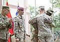 U.S. Marine Corps Gen. Joseph F. Dunford Jr., right foreground, embraces Army Gen. Lloyd J. Austin III, the commander of U.S. Central Command, during the International Security Assistance Force and U.S 140826-D-HU462-619.jpg