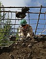 U.S. Marine Corps Lance Cpl. Bennett Russ, with the 9th Engineer Support Battalion, hammers loose chunks of concrete during renovation work at Erdmiin Oyun High School in Nalaikh district, Ulaanbaatar, Mongolia 130721-M-DR618-036.jpg